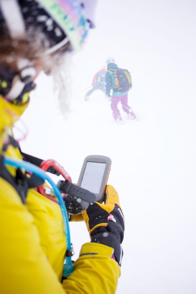 Freeriderin mit GPS im Whiteout